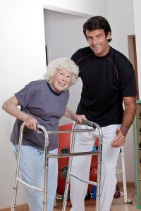 Neurological rehabilitation physiotherapy - Patient with walker