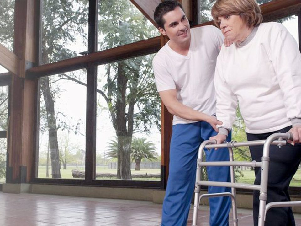 Physiotherapist and woman with walker